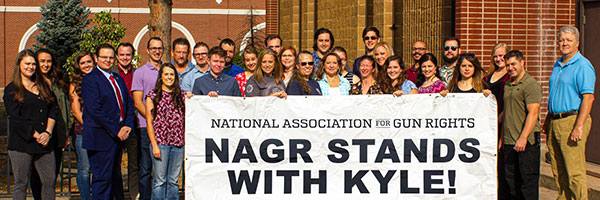National Association for Gun Rights and National Foundation for Gun Rights staff stand with Kyle Rittenhouse